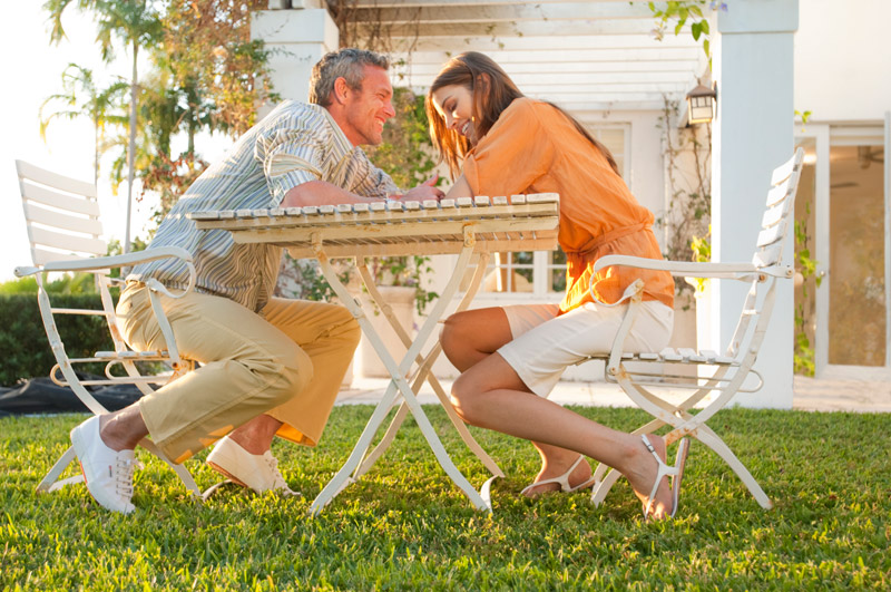 couple seated at table outdoors