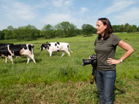 Edwina photographing at a dairy farm